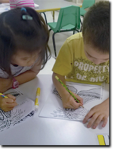 Boy and girl drawing a volcano