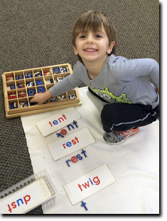 Boy matching the letters with the pictures