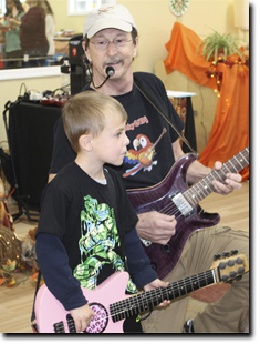 Father and son performing a song