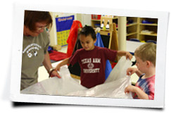 Children helping their teacher