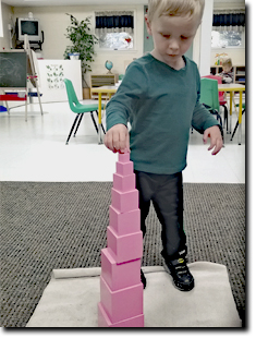 boy stacking the boxes